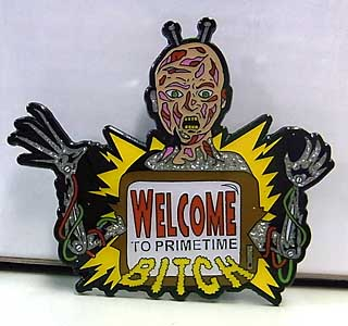 VILE CONSUMPTION ENAMEL PIN WELCOME TO PRIMETIME BITCH